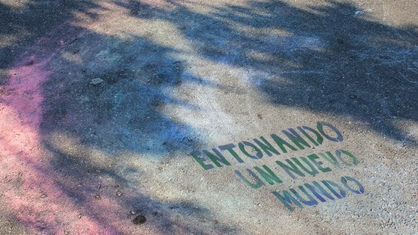 poetic stencil image on cement